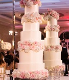 five-tiered ivory wedding cake with blush roses
