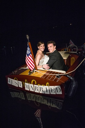 Bride and groom in 'Just Married' lake boat