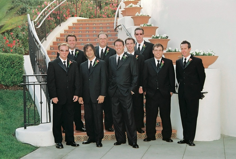 Groomsmen in tuxedos at Bacara steps