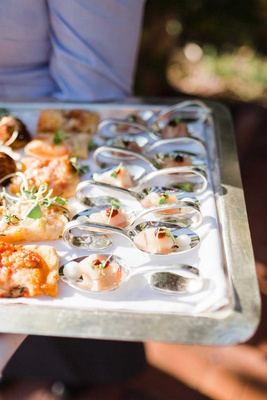 wedding reception cocktail hour hors d'oeuvres appetizers flatbread pizza and fish sushi on a tray