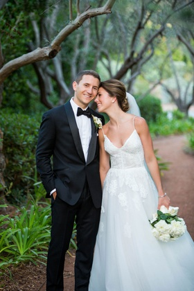 bride in spaghetti strap monique lhuillier wedding dress lace flower design groom in tuxedo bow tie