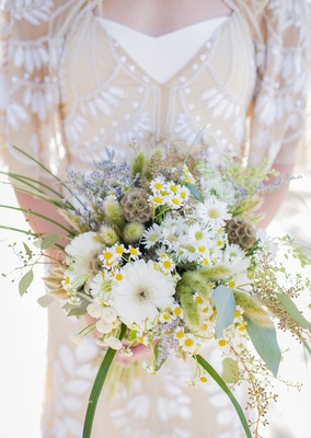 brides wildflower bouquet different flowers blooms daisies green leaves lilacs olive leaves