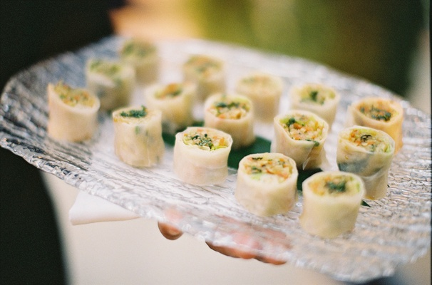 Thin rice paper egg rolls on clear platter