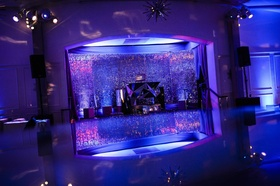 Disco ball wall and illuminated dance floor