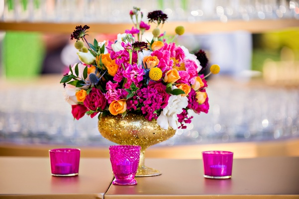 La film producers wed in a vibrant pink gold and chevron wedding flower arrangement with pink and orange roses in gold glitter vase mightylinksfo