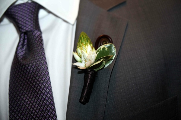 Flower boutonniere with protea-like flower and fern
