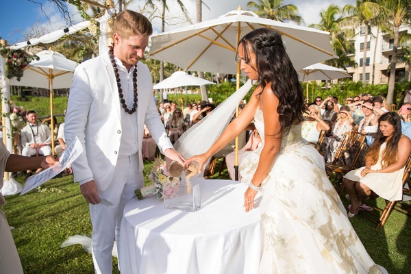 Joshua Faulner and Chudney Ross sand ceremony at wedding Montage Kapalua Bay lawn