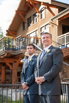 Groom and best man waiting for bride at outdoor wedding ceremony in Montana