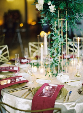 round wedding table glass top ivory linen gold flatware charger burgundy napkin gold centerpiece