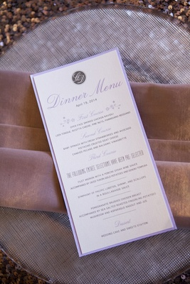 Purple-bordered dinner menu with monogram