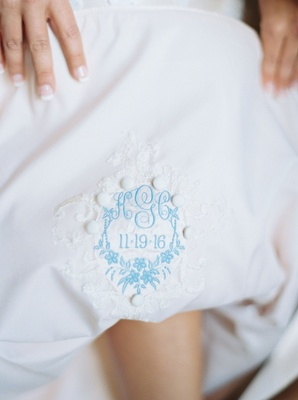 Bride pulling up dress romona keveza with something blue embroidery wedding dress french manicure