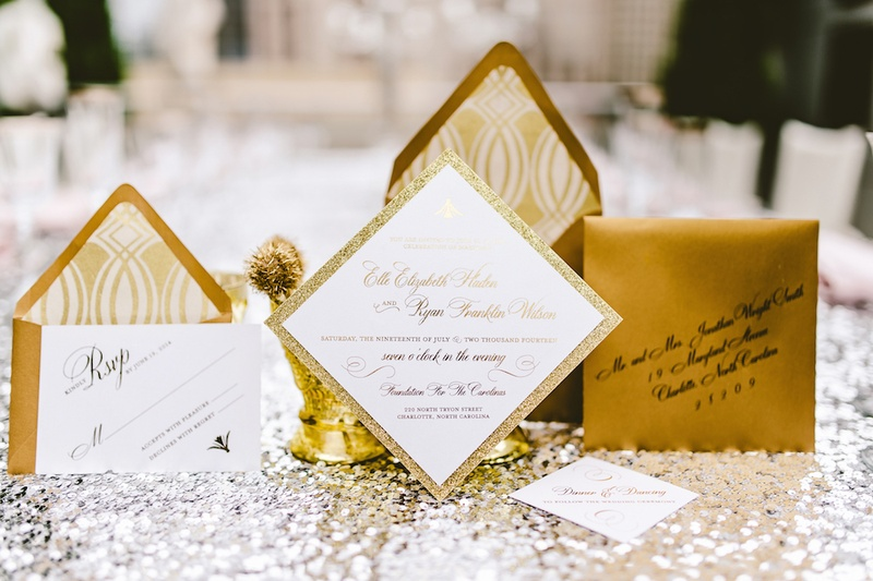 Olive Paper gold wedding invitation suite on silver sequin tablecloth