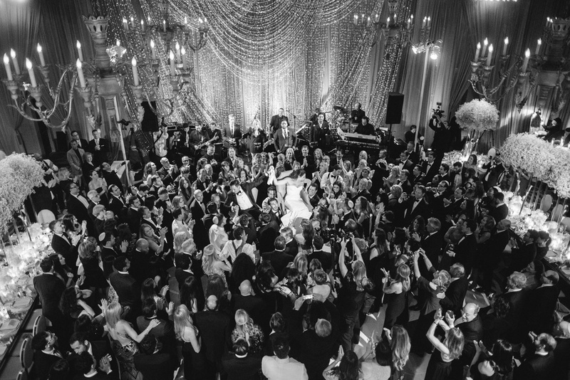 Black And White Photo Of Bride Groom Doing Hora Jewish Wedding Reception Tradition Guests