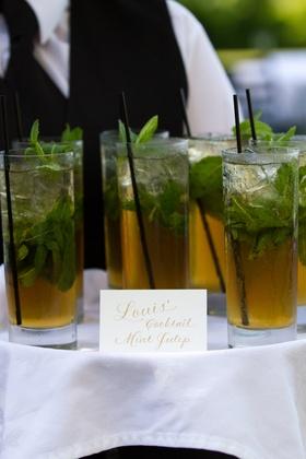 Groom's signature wedding drink with mint garnish