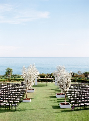 Montage Laguna Beach lawn wedding with white trees on aisle