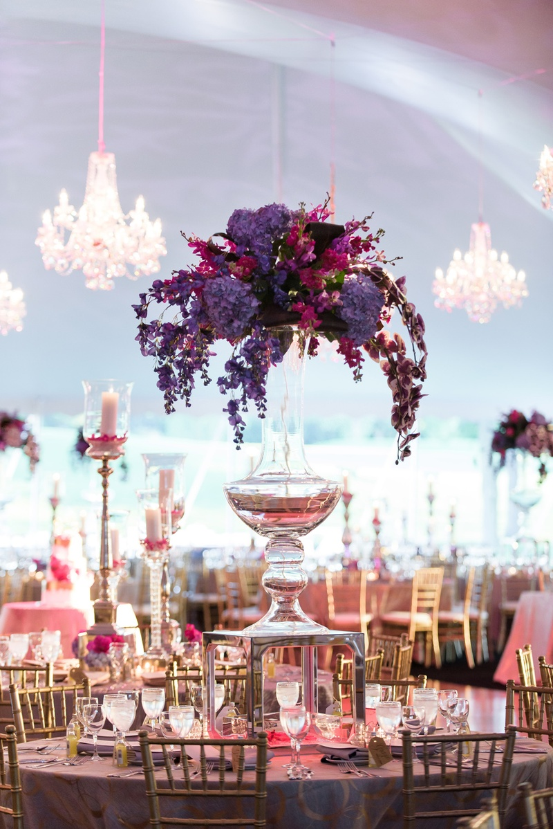 wedding centerpiece with purple hydrangeas and blossoms in pink and fuchsia