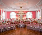 pink reception space long tables tall florals chandeliers sequin linens greenbrier southern venue