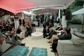 Moroccan-style wedding lounge with guests on sofas and couches