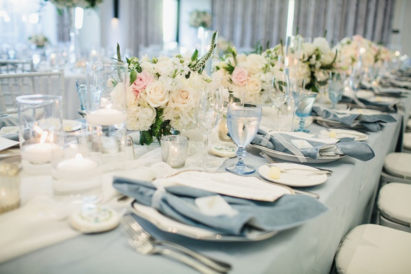wedding reception long table low centerpiece blush ivory light blue linen and velvet napkin luxe
