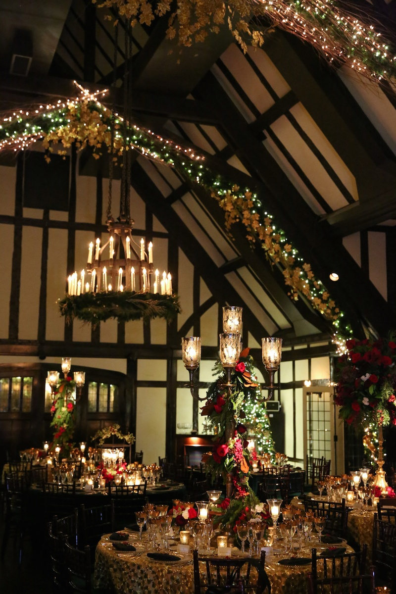 Wedding reception with Christmas decorations, lights, candelabra, and chandeliers with candles