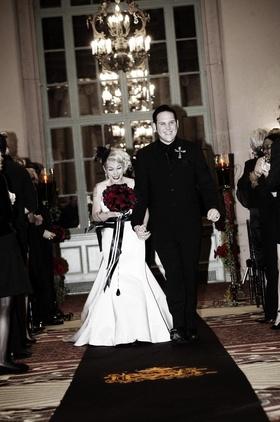 Brandon Saller, drummer of Atreyu, with bride in a stapless Alvina Valenta dress with a black sash