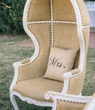 Tufted dome chairs on grass with custom pillow
