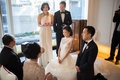 Bride and groom kneeling during traditional Chinese tea wedding ceremony before other ceremony