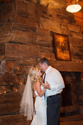Bride and groom in Big Sky, Montana with first dance by fire place