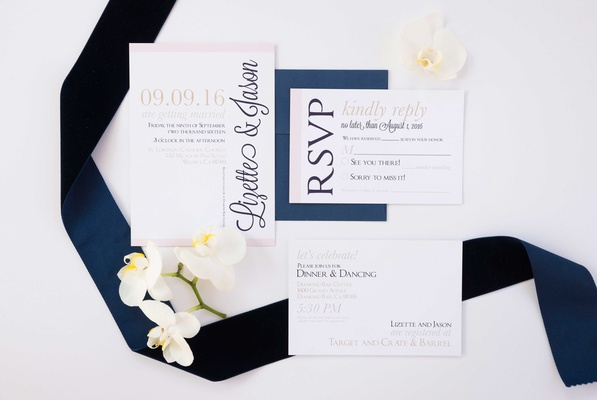 simple blue white invitation suite white orchids ribbon calligraphy