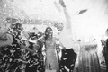 Black and white photo of confetti exploding at New Year's Eve wedding reception in Atlanta