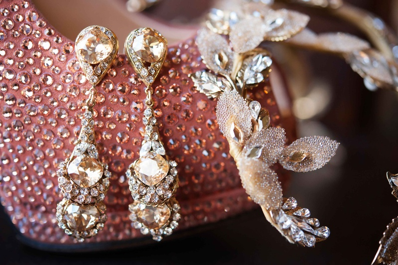 Diamond drop earrings for wedding day jewelry displayed on crystal pink bridal shoe