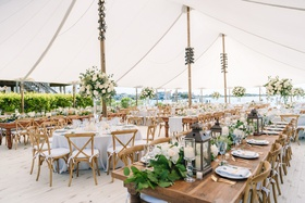 backyard tented wedding reception, garland runner with lanterns