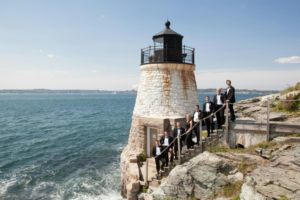 Groomsmen on steps by Rhode Island lighthouse