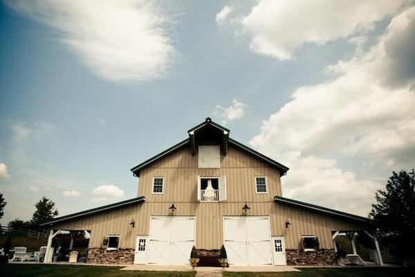 Wedding dress in window of barn house
