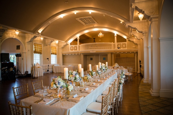 antique style ballroom and long table decorated with candles and flowers