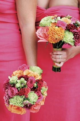 Pink bridesmaid dresses with colorful vibrant bouquet