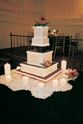 Architectural cake surrounded by candles