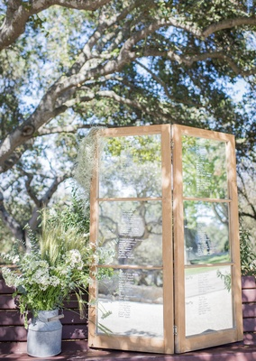 mirror to write a message to the couple rustic white and green wildflowers on display
