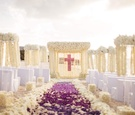 Christian cross beach wedding with purple flowers