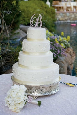 Four layer cake with embroidered details