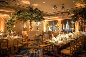 Wedding reception with nature decorations candelabra centerpieces