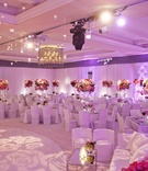 Ballroom illuminated with purple lighting and roses