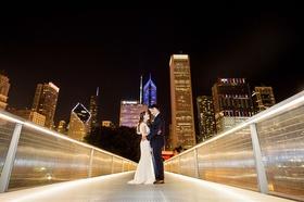 Wedding portrait night photo bride and groom on bridge in Chicago, Illinois