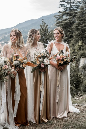 bridesmaids at lake como wedding ceremony boho chic style earth colored dresses long capes bouquets