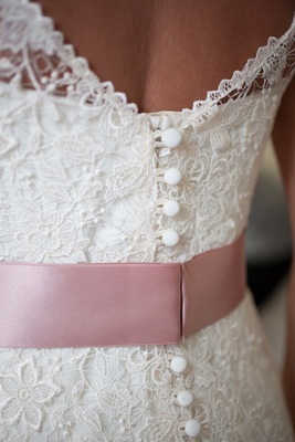 Lela Rose lace wedding gown with blush satin ribbon detail