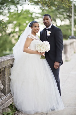 bride in legends romona keveza gown with illusion neckline tulle skirt, groom in jos. a. bank tux
