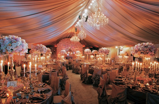 Draped fabric above luxurious round tables