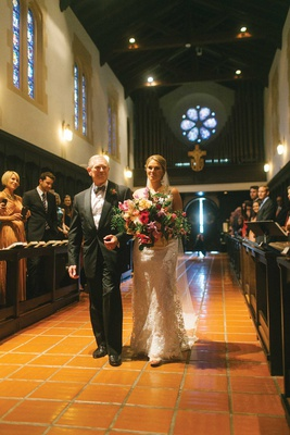 bride walking down aisle terracotta tiles father of bride tropical bouquet pews