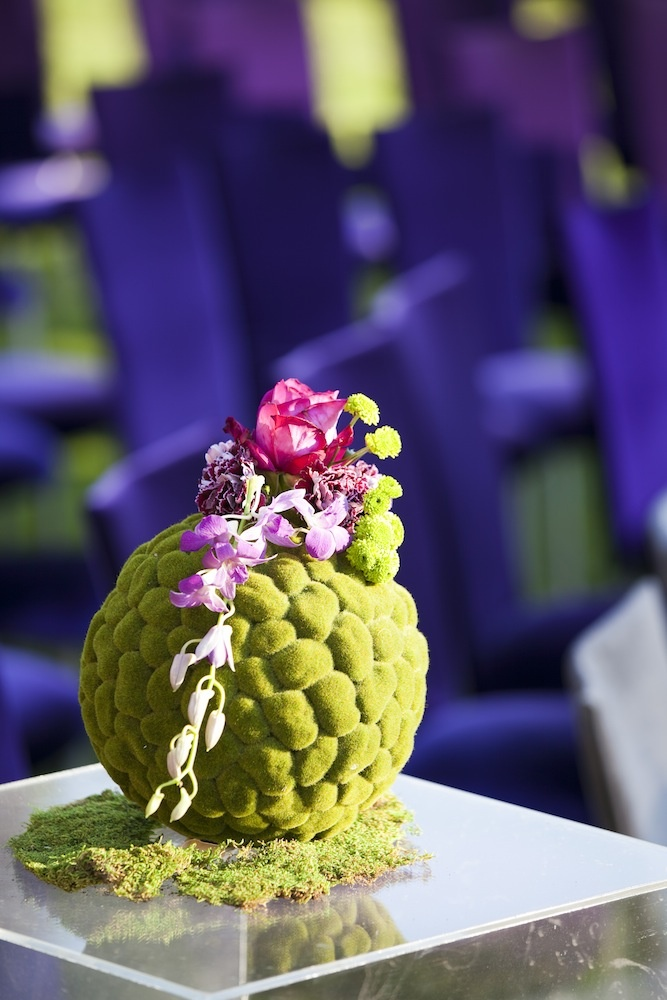 Green moss sphere with pink rose and purple orchids
