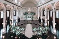 vibiana indoor wedding ceremony, indoor wedding with white and green floral arrangements